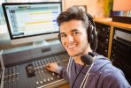 Student mixing audio in a studio